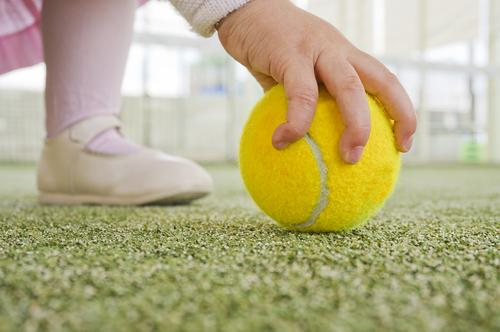 child-playing-artificial-grass